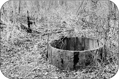 Old oil well with wooden storage tank.