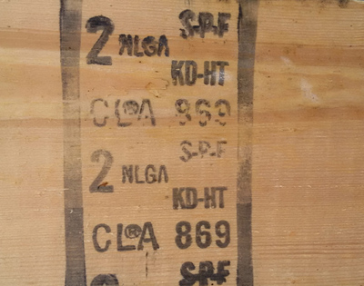 Figure 1. This figure shows an example of a lumber grade stamp markings on a  piece of wood.  This lumber has been graded in accordance with NLGA grading rules by the Canadian Lumbermen's Association and was produced by Mill number 869.  The lumber is Spruce-Pine-Fir species, kiln dried (KD) and heat treated (HT), and assigned Number 2 grade.