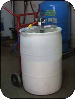 Photo 18. Whole milk in this extra barrel has been acidified and is sitting for a few hours contact time with formic acid.