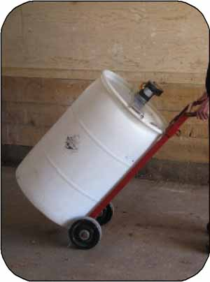 Photo 19. A dolly eases transportation of a barrel to a warm box.