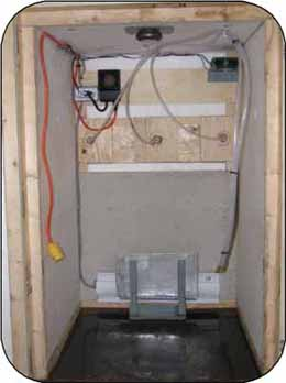 Photo 7. An interior view. A 300-watt baseboard heater is the heat source and it is protected by a barrel stop.